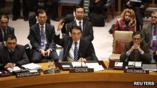 Chinese Ambassador to the United Nations Li Baodong votes to block a Security Council resolution backing an Arab League call for Syrian President Bashar Assad to step down, at UN headquarters on 4 February 2012