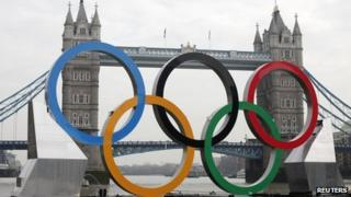Olympic rings positioned in front of Tower Bridge on the River Thames