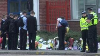 Pupils and police at the flower tributes outside Portchester School