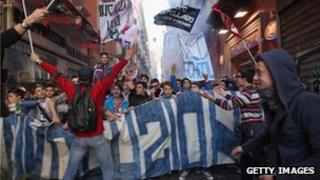 Students and the unemployed take part in a protest against austerity cuts and lack of jobs in Naples