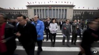 Delegates leave the Great Hall of the People after attending the opening session of the Chinese People's Political Consultative Conference (CPPCC) in Beijing, 3 March 2012