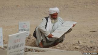 Hakim the undertaker in a cemetery around 10km north of Kandahar city