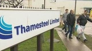 Workers leaving the meeting with Thamesteel's administrators