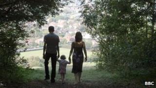 Family walking through trees