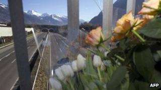 Flowers are placed on a bridge overlooking the road tunnel near Sierre, Switzerland, 15 March