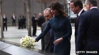 Samantha Cameron, accompanied by her husband David, lays flowers at the World Trade Center Memorial
