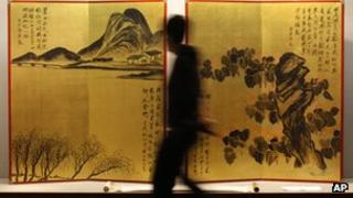A rare pair of gold screens by Chinese artist Qi Baishi at a Sothebys auction preview
