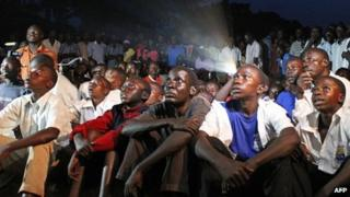 Ugandans watch the screening of Kony 2012, a 30-minute YouTube film uploaded by US campaign group Invisible Children, in Lira district, on 13 March 2012
