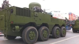 Chinese military vehicle on unidentified city street