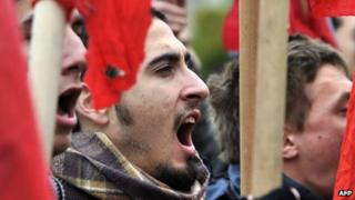 Students shout at a protest of austerity cuts in Athens in February