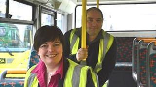 Hannah Beacom and Toby Boucher sat in a Guernsey Bus