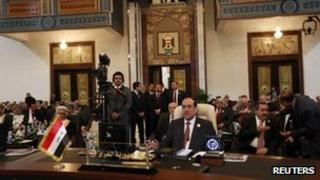 Nouri al-Maliki at the summit sitting with other delegates behind him