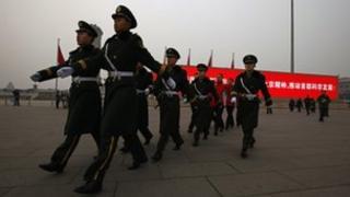 Paramilitary policemen patrol on Tiananmen Square - archive image