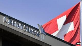 Credit Suisse sign and Swiss flag - file pic