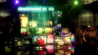 A stack of television screens show Newsround presenters from the 40 year history of Newsround.