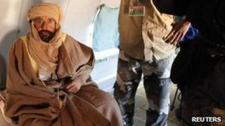 Saif al-Islam Gaddafi is pictured sitting in a plane in Zintan 19 November, 2011