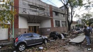 Residents inspect the damage cause by a storm in Buenos Aires