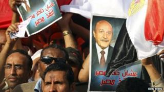 Supporters of Egypt's former vice president Omar Suleiman in Abassiya Square in Cairo April 6, 2012