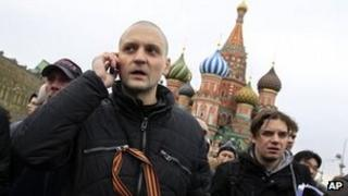 Russian opposition figure Sergei Udaltsov speaks into a phone on Red Square Moscow, 8 April