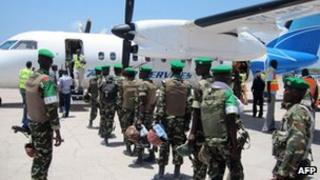 AU troops boarding a plane in Mogadishu to head for Baidoa, 5 April 2012