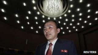 Ryu Kum-chol of North Korea, Deputy Director of the Space Development Department of the Korea Space Technology Committee, leaves after holding a news conference in Pyongyang 10 April, 2012