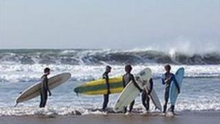 Surfers at Woolacombe Beach, Devon