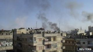 Smoke rises from the Al Qusoor district of Homs