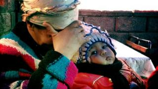 An Uzbek woman and child