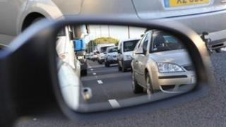 Traffic reflected in a wing mirror
