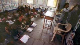 School children sit on the floor in an Indian classroom in a village called Endhal in Gujarat