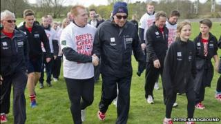 Celtic manager Neil Lennon joined Sir Ian Botham on his charity walk