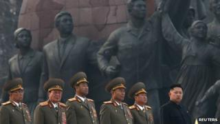 Kim Jong-un (far right) attends the unveiling of statues of Kim il-Sung and Kim Jong-il in Pyongyang, 13 April