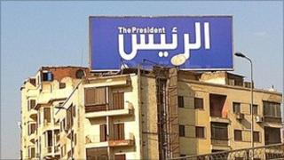 "Sign reading ""al rais"", ""the president"" on top of a building in Giza."