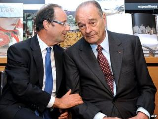 Francois Hollande (L) and Jacques Chirac talk at the inauguration of an exhibition dedicated to Chinese art in the Correze department of south-central France (10 April 2012)