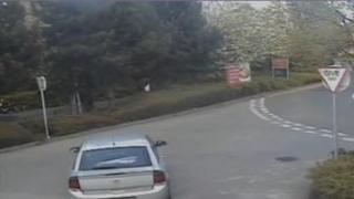 An umbrella on back parcel shelf of Gilroy's car, caught on CCTV
