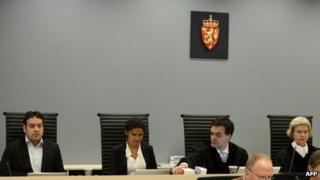 Judges sit in the courtroom on the second day of Anders Behring Breivik's trial (17 April 2012)