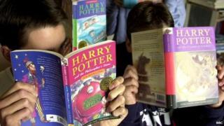 Children reading Harry Potter