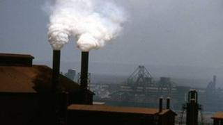Somke plumes coming from industrial chimneys in China