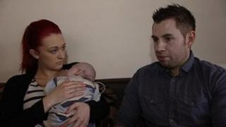 Charmaine Malcolm and Neil Lewis with baby