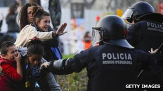 Spanish riot police and protesters in Barcelona, 29 Mar 12