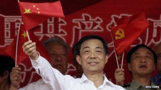 Bo Xilai waves a Chinese national flag. File photo