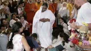 "Sri Mata Amritanandamayi Dev, the hugging saint known as ""Amma"" (mother) has her feet washed before she begins embracing followers"