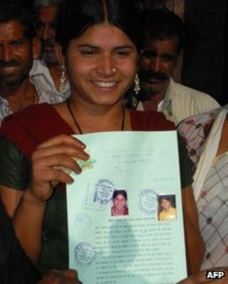 Laxmi Sargara holds up the document that annuls her child marriage