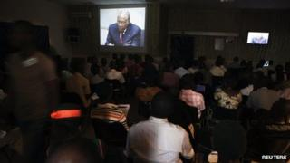People at the Special Court for Sierra Leone watch a live broadcast of the verdict being delivered by a United Nations-backed court in the Hague convicting former Liberian president Charles Taylor of war crimes, in the country's capital Freetown April 26, 2012.