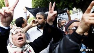 Salafists protest against Nabil Karoui, the owner of Nessma, outside a court in Tunis on 19 April 2012