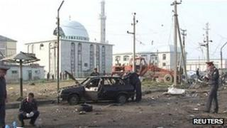 Police inspect the scene of a bomb blast in Makhachkala, Dagestan, 4 May