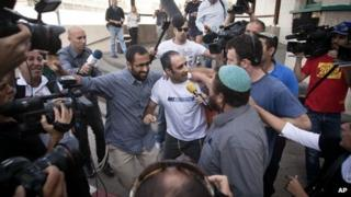 Hagai Amir speaks to reporters as he leaves Ayalon prison (4 May 2012)