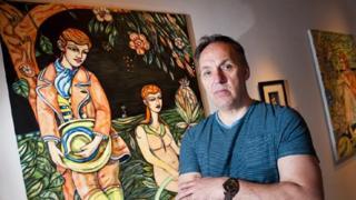 Adrian Wiszniewski with one his paintings