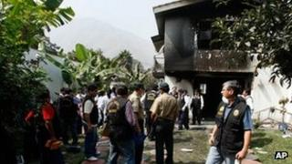 Police officers at the site of the fire at the Sacred Heart of Jesus clinic in Chosica, Peru.