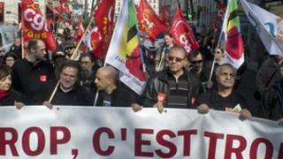 Protesters demonstrate in the French eastern city of Lyon as part of the European Day against austerity plans. Banner reads: 'Enough is enough